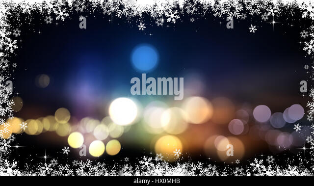 Festive Christmas background with bokeh lights and snowflakes - Stock Image