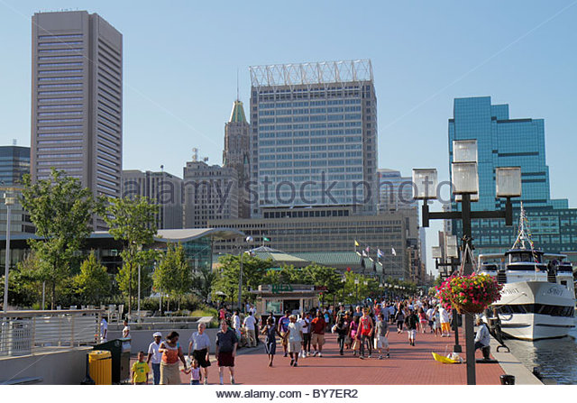 Baltimore Maryland Inner Harbor Harborplace Patapsco River waterfront festival marketplace attraction Black man - Stock Image