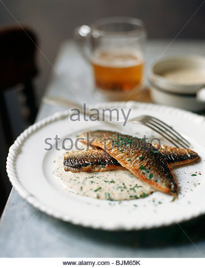 Fried Trout with Herbed Cream Sauce - Stock Image