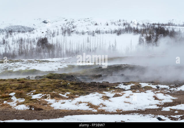 Steam escaping from the thermal pools at Geysir in Iceland - Stock Image