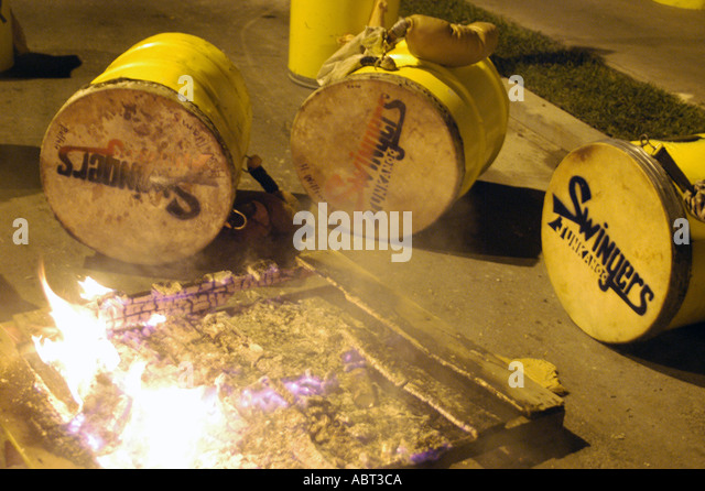 BAHAMAS Junkanoo Fire Tightens Cowskin drums befofre parade - Stock Image