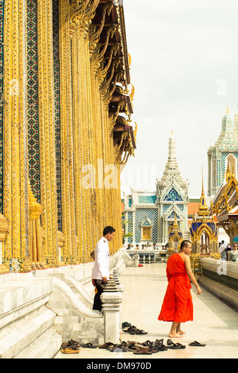 Wat Phra Kaew or temple of emerald buddha in Bangkok Grand palace. A ceremony with monks was in the temple. - Stock-Bilder