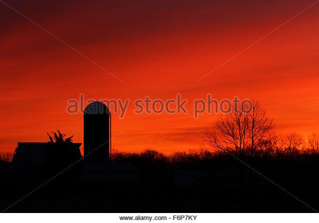 Farm at sunrise - Stock Image