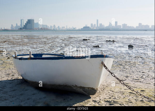 Fishing boat on waterside overlooking Manama, Bahrain, Middle East - Stock Image