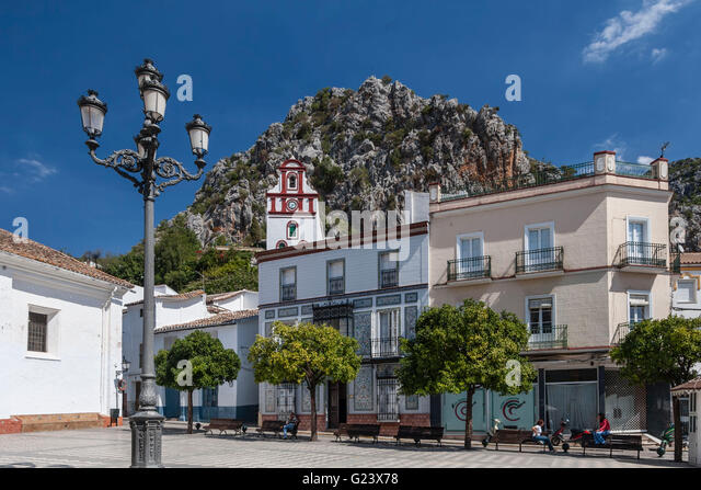 white town of Grazalema, bell tower, square, Andalusia, Spain - Stock Image