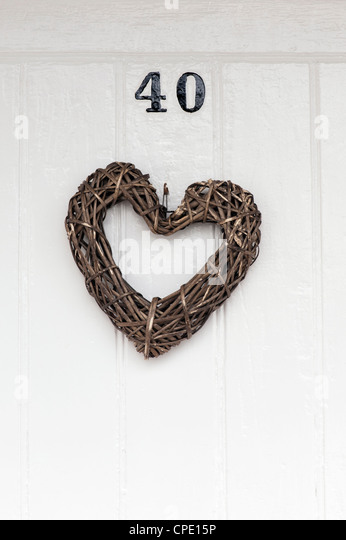 Craft Wooden heart on a front door - Stock Image