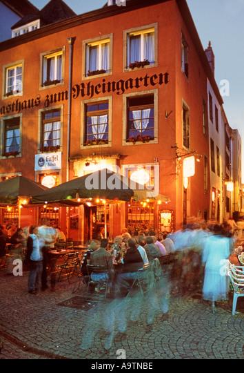 Germany Cologne Koeln Gasthaus zum Rheingarten terasse people - Stock Image