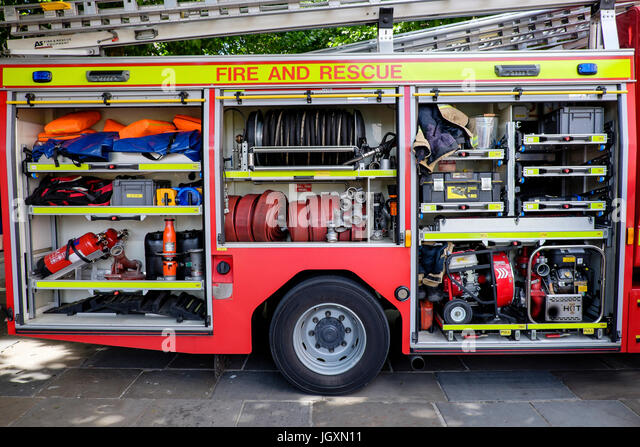 Firefighting fire-fighting and rescue equipment in a British fire engine truck tender. - Stock Image