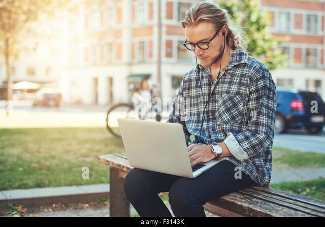 Entrepreneur working on idea on his laptop. city lifestyle - Stock-Bilder