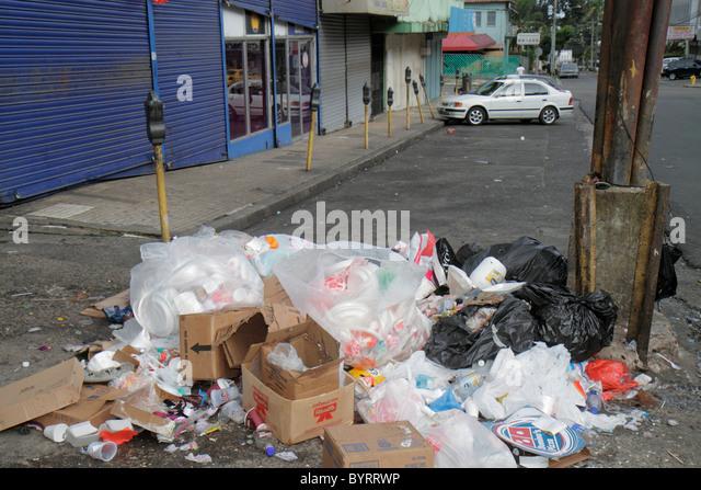 Panama Panama City Calidonia lower-class neighborhood street scene trash pile garbage pollution plastic bags sidewalk - Stock Image