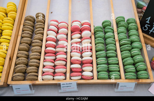 Colourful macaroons lined up at Chester Food Festival - Stock Image