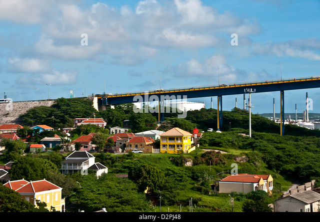 Queen Juliana Bridge carries traffic across St. Anna Bay channel at Willemstad, Curacao - Stock Image