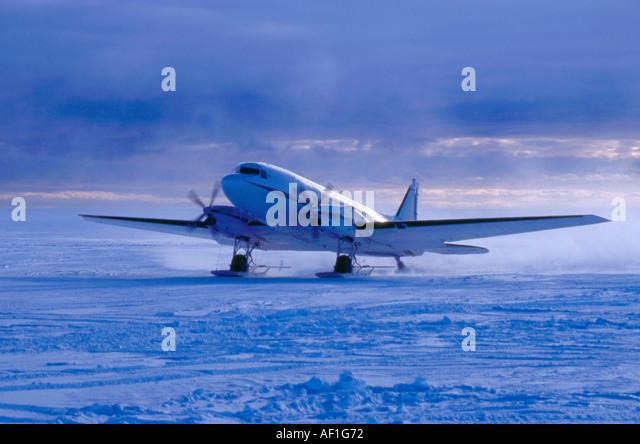 A Basler converted DC3 (BT-47) lands at Halley Bay Antarctica - Stock Image
