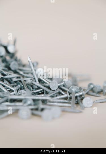 heaped pile of galvanized nails - Stock Image