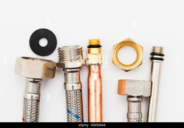 Copper pipes plumber stock photos copper pipes plumber for Flexible copper tubing water heater