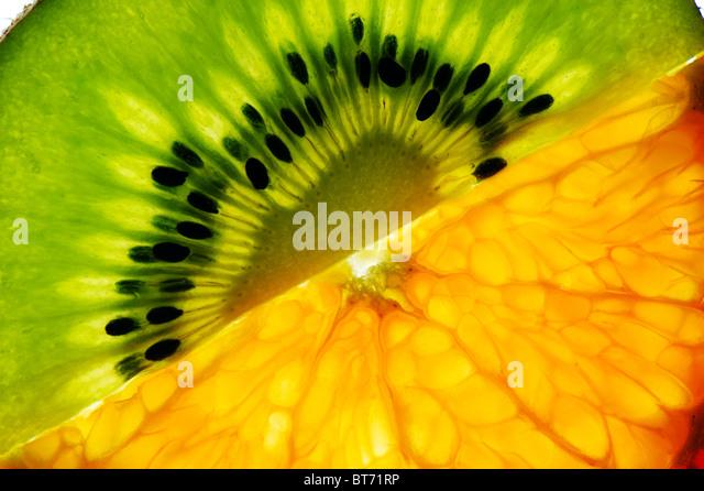 Sliced kiwi and mandarin - Stock Image