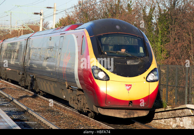 virgin trains british rail class 390 train 390 128 city of preston speeding along - Stock Image