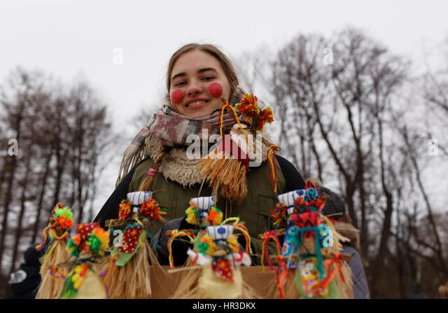 St. Petersburg, Russia, 26th February, 2017. Woman selling the effigies of Maslenitsa during Shrovetide celebrations - Stock Image