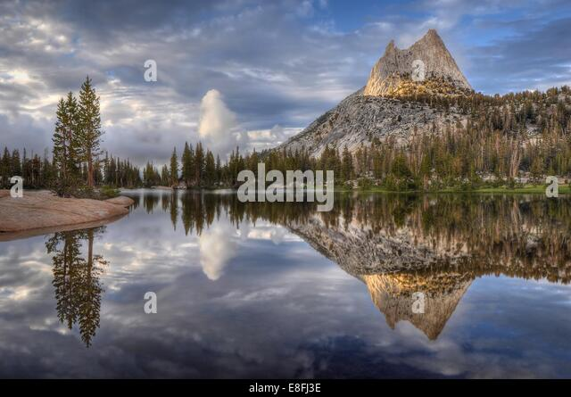 USA, California, Yosemite National Park, Afternoon reflections in Cathedral Lake - Stock Image