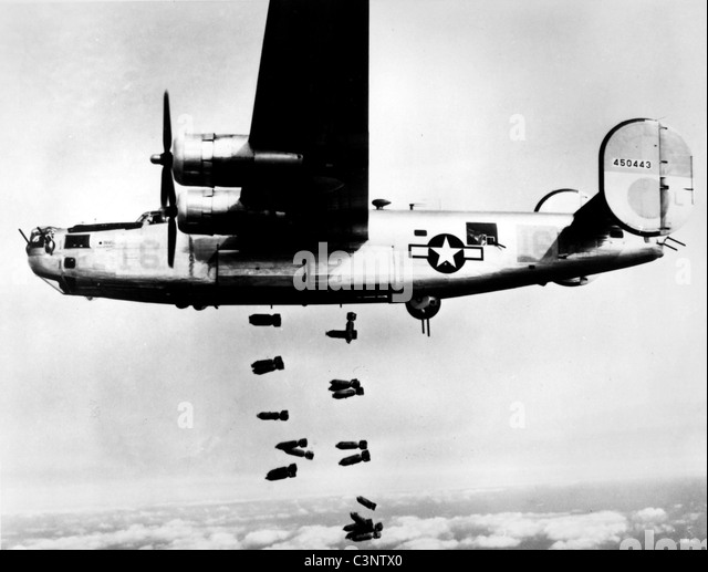 A consolidated B-24 Liberator of the 15th A.F. releases its bombs on the railyards at Muhldorf, Germany on 19 March - Stock-Bilder