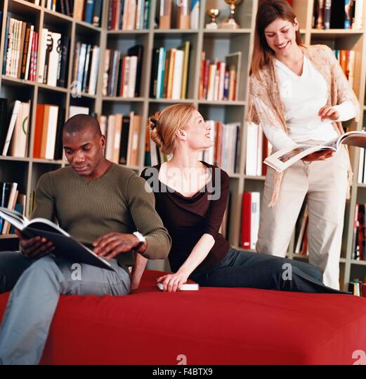 book color image dark skin diversity education library man reading Scandinavia school several study Sweden woman - Stock-Bilder