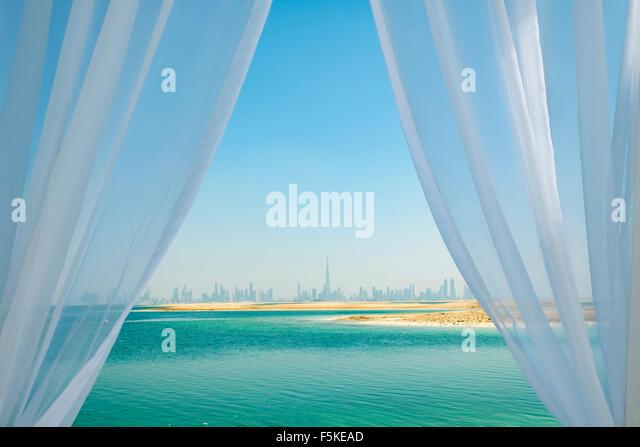Skyline of Dubai from The Island Lebanon beach resort on a man made island, part of The World off Dubai, United - Stock-Bilder