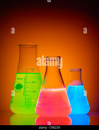 Flasks of glowing liquid - Stock Image