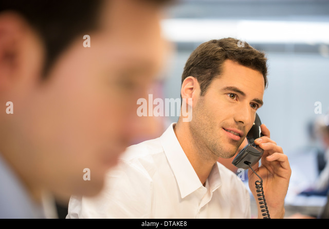 Businessman on the phone at the office - Stock Image
