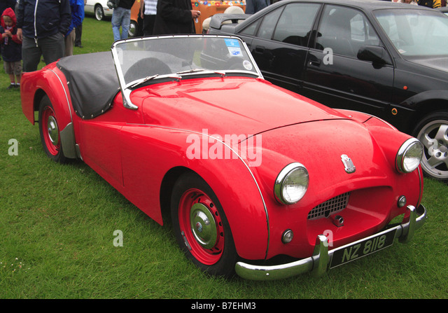 Triumph TR2 red classic car vehicle motor sport convertable chrome UK English British oldtimer - Stock Image