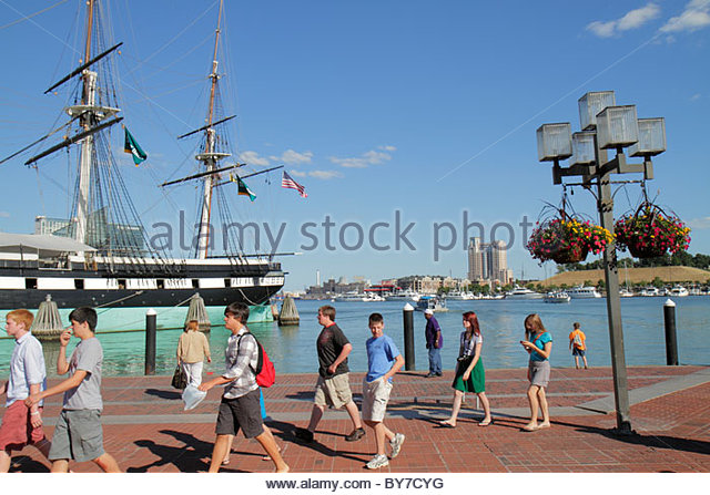 Baltimore Maryland Inner Harbor Patapsco River port waterfront promenade Harborplace attraction water taxi USS Constellation - Stock Image
