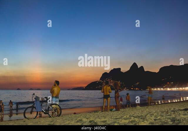 visitors atIpanema beach, Rio de Janeiro, Brazil - Stock Image