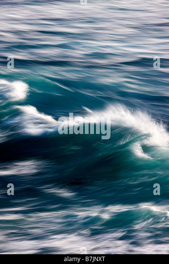 Pacific Ocean waves crashing ashore at Fanshell Overlook, Pebble Beach, Monterey Peninsula, California, USA - Stock Image