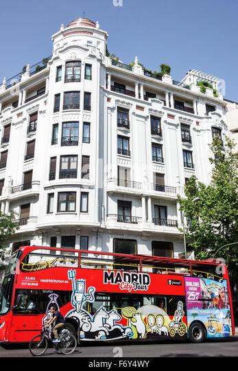 Spain, Europe, Spanish, Hispanic, Madrid, Centro, Calle Genova, city tour double decker red bus, coach, residential - Stock Image
