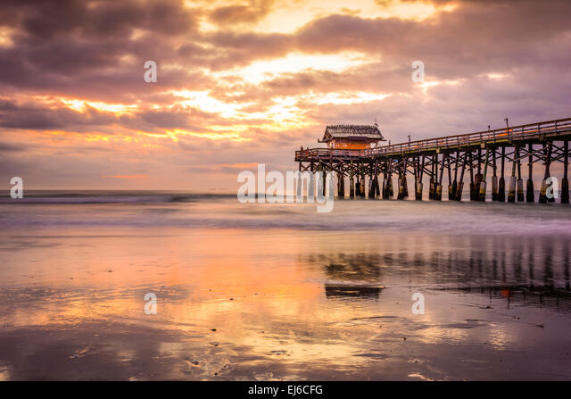 Cocoa Beach, Florida, USA beach and pier at sunrise. - Stock Image