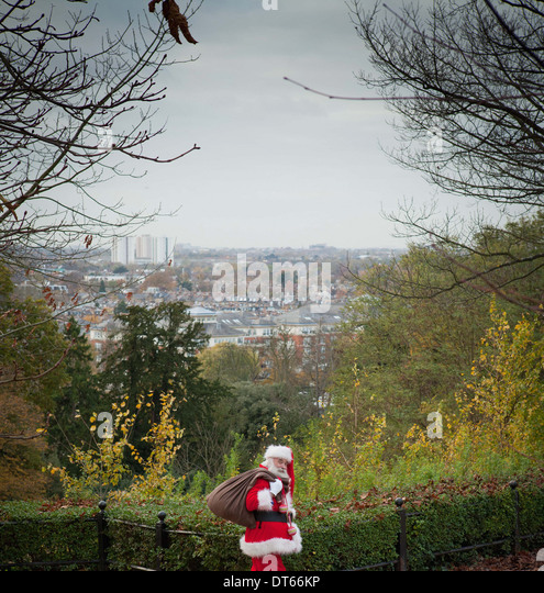 Santa Claus carrying sack over shoulder - Stock-Bilder
