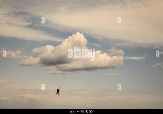 Mature man, kite surfing - Stock Image