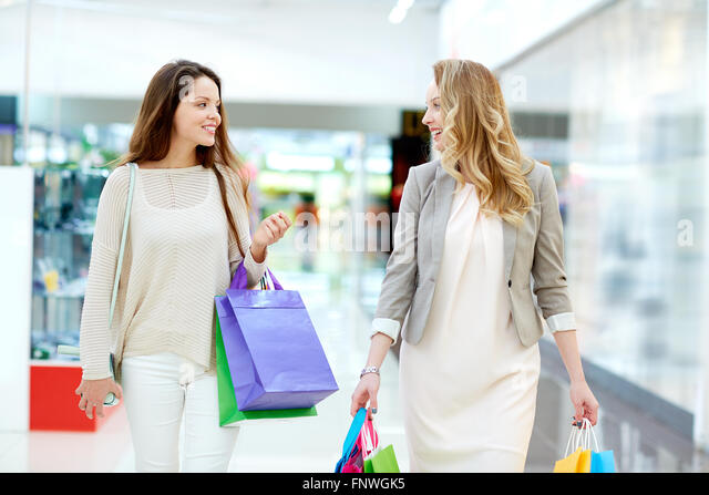 Elegant young shoppers spending time in the mall - Stock Image