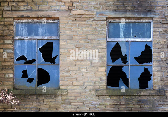 Broken windows in a disused mill, Halifax, West Yorkshire - Stock Image