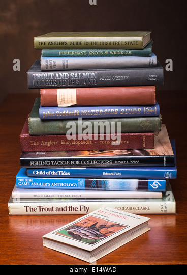 A stack of angling fishing books - Stock Image