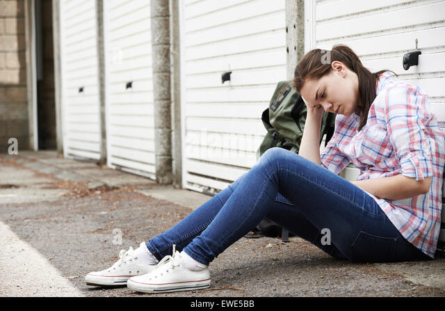 Homeless Teenage Girl On Streets With Rucksack - Stock Image