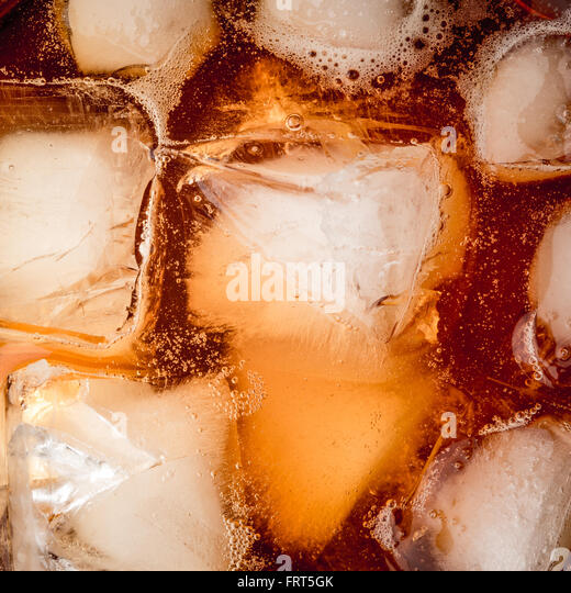 Rum with ice background square - Stock Image