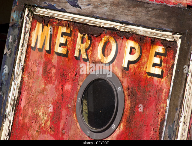 Merope a decaying British canal boat in red - Stock Image