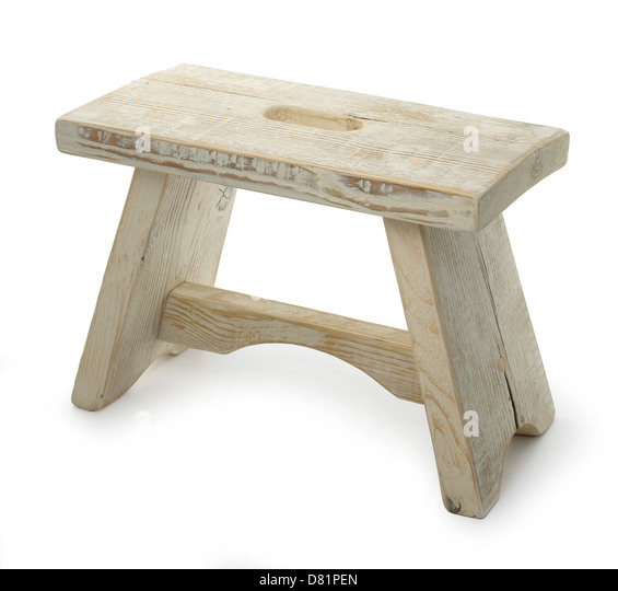 low wooden milking stool cut out onto a white background - Stock Image