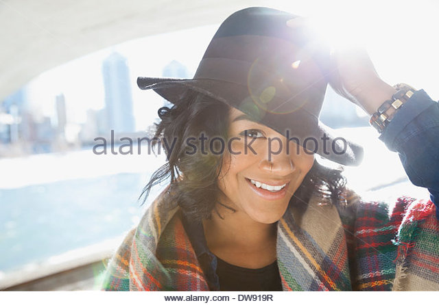 Portrait of smiling woman with hat - Stock Image
