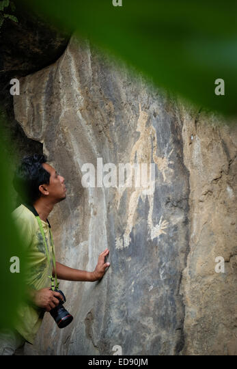 Archaeological rock painting at a small village of Lamagute in Lembata Island, Indonesia. - Stock Image