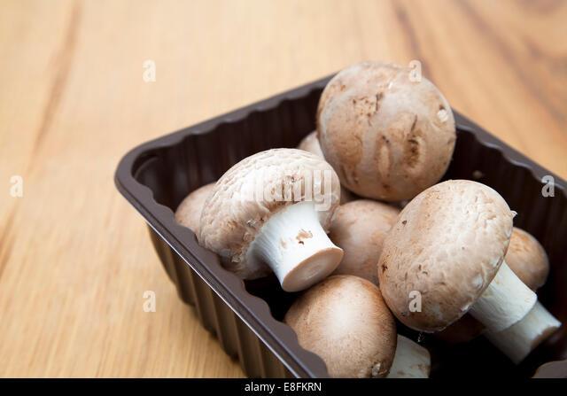 Punnet Of Mushrooms - Stock Image