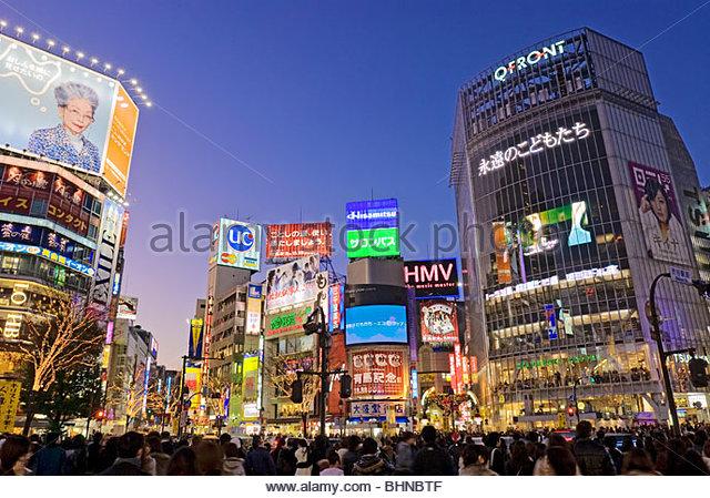 Shibuya Crossing, Hachiko Square, Tokyo Skyline, Japan, Neon Advertising Billboards. - Stock Image