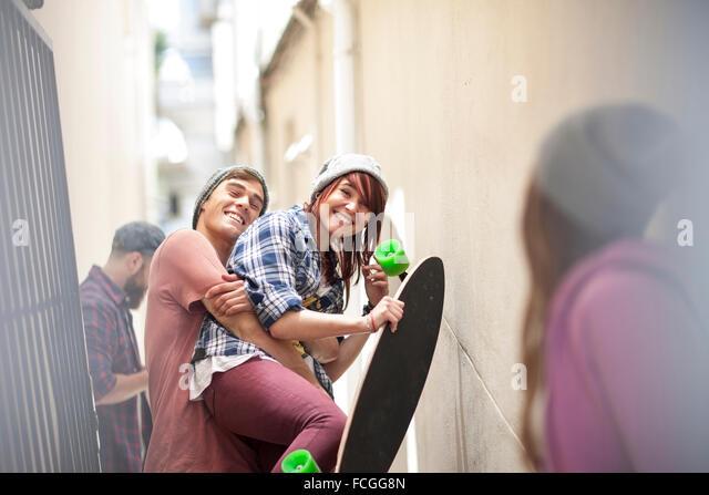 Friends   skateboard having fun in a passageway - Stock Image