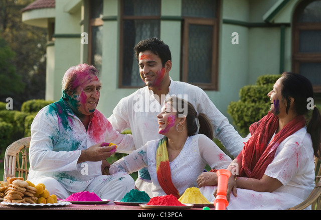 Family celebrating Holi - Stock Image
