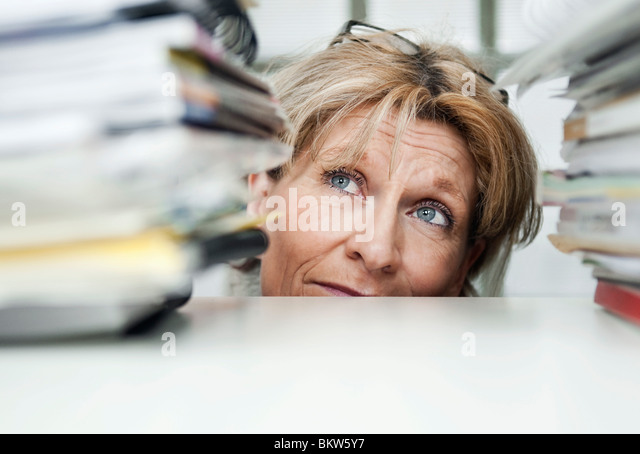 Woman between pile of books - Stock Image
